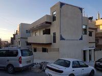 Building in New Zarqa-photo @index
